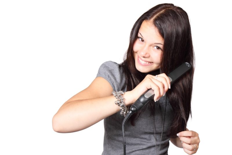 women using hair flat irons